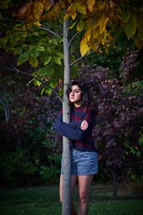 Tree hugger (masennott11) Tags: yellow red blue posing photoshoot model girl bokeh 50mm a6500 nature 35mm light sun landscape forest autumn fall sweater woman colorful portrait trees tree