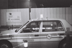 Not your ride (Elios.k) Tags: film analoguephotography scannedfilm ilfordhp5plus blackandwhite monochrome analogfilm grain contrast canona1 horizontal outdoors peopleoneperson man mask facemask surgicalmask japanese look looking taxi taxidriver cabdriver waiting car night lights reflection reading japanesecharacters kanji cab travel travelling vacation canon a1 camera photography december 2017 analogcamera hachinohe aomoriprefecture tōhokuregion tohoku honsu asia japan