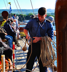 Scotland West Highlands Argyll a crew member of the paddle steamer Waverley getting ready to throw a docking line at Brodick Pier Island of Arran 1 July 2018 by Anne MacKay (Anne MacKay images of interest & wonder) Tags: scotland west highlands argyll seaman crewman paddle steamer waverley passengers evening brodick pier island arran 1 july 2018 picture by anne mackay
