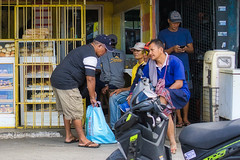 Outside of the Bakery (Beegee49) Tags: street men shop bakery discussion sitting talking luminar sony a6000 happy planet silay city philippines asia