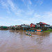 Students on Boats passing Kampong Phluk Floating Village in Cambodia