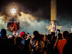 Anonymous Protest on Guy Fawkes Night (deepaqua) Tags: trafalgarsquare smoke streetlamp night anarchist nationalgallery sign protest guyfawkesnight guyfawkes anonymous