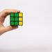 Hand holding Rubik's cube