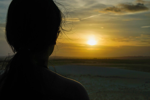 Person looking at the Sunset from a Mountain in the White Sand Dunes in Mui Ne