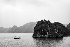 Lonely fisher (gambajo) Tags: vietnam halong water sea seascape fisher fisherman boat rocks islands halongbay bay asia boot fischer see meer landschaft moody romantic