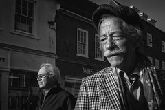 Classic lines (markfly1) Tags: england europe uk chichester candid street image photo photograph classic black white conversion mono monochromatic baw bw old elderly gent man men dapper well groomed fashion fashionable debonair cap scarf moustache cravat collars windoes side profile lovely light lighting shop fronts checked jacket plaid nikon d750 35mm manual focus lens