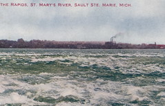 """UP Sault St. Marie MI AMUSEMENT 1909 A WILD CANOE RIDE ON THE ST MARYS RIVER RAPIDS and Hey WHERE ARE THEIR LIFE JACKETS Betcha that Canoe Charter is not USCG APPROVED4 (UpNorth Memories - Donald (Don) Harrison) Tags: vintage antique postcard rppc """"don harrison"""" """"upnorth memories"""" upnorth memories upnorthmemories michigan history heritage travel tourism restaurants cafes motels hotels """"tourist stops"""" """"travel trailer parks"""" cottages cabins """"roadside"""" """"natural wonders"""" attractions usa puremichigan """" """"car ferry"""" railroad ferry excursion boats ships bridge logging lumber michpics uscg uslss"""