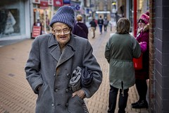 Life Is Hard (Leanne Boulton) Tags: urban street candid portrait portraiture streetphotography candidstreetphotography candidportrait streetportrait eyecontact candideyecontact streetlife old elderly man male face eyes expression mood feeling glasses hat coat winter cold grime dirt poverty difficult poignant socialdocumentary tone texture detail depthoffield bokeh gritty naturallight outdoor light shade city scene town human life living humanity society culture lifestyle people canon canon5dmkiii 50mm primelens ef50mmf14usm color colour barnsley england uk