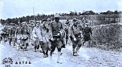 Column  of German prisoners taken at St. Mihiel drive by 5th Div. 10-12-18 Rogeville, Meurthe et Moselle, France NARA111-SC-42732-ac (over 17 MILLION views Thanks) Tags: stmihiel pow ww1 worldwari france dog frenchboys smock schoolboys aef 1918