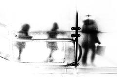 mother and children on an escalator (Gerrit-Jan Visser) Tags: bewerkt streetphotography amsterdam central station mother children pedestrian escalator vague sketch blackandwhite bnw metro