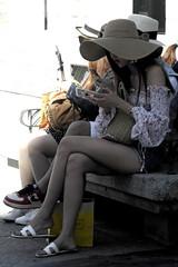 I soliti riti (Giangaleazzo) Tags: segovia spain spagna nikon coolpix city history ancienttown ragazza elegant girl oriental hat legs woman donna mobile cell cellular bench sitting panca rest riposo pausa gambe girls