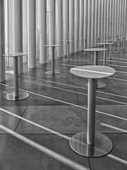 Café in Luxembourg Philharmonie (RobertLx) Tags: europe luxembourg city architecture concerthall café lines monochrome bw building modern contemporary column table geometric shadow philharmonie interior