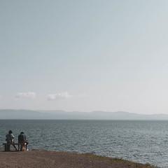 Sit (Erik Schepers) Tags: minimal minimalistic color light shadow blue white greece halkidiki travel people sitting sea ocean coast mountain landscape