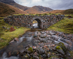 The Old Stone Bridge (stefanblombergphotography.com) Tags: clouds flow grass hill hillside landscape light mountain nature outdoor rock sky stefanblombergphotography stone stream water waterfall wwwstefanblombergphotographycom