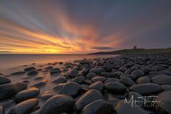 Morning glow. (miketonge) Tags: northumbria northumberland embleton dolerite boulders dunstanburgh sunrise longexposure nisi nikon d850 1424 sea northsea beach rocks castle dunstanburghcastle
