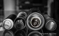 Day 338. (lizzieisdizzy) Tags: blackandwhite blackwhite black whiteandblack white whiteblack reflections reflection cans aerosol tins nozzeles propellant container volaitle compound fragrance