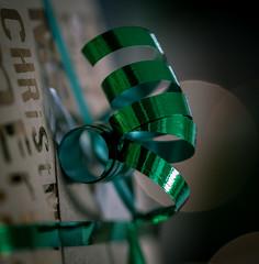 Giving Bokeh - HMM (Matthew Johnson1) Tags: familywalk macromondays holidaybokeh bokeh holiday gift present christmas wrapping giving macro monday gold sparkles dof ribbon paper