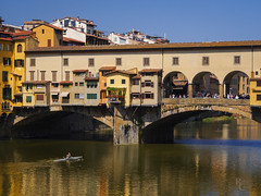 Ponte Vecchio Color (RobertCross1 (off and on)) Tags: 1250mmf3563mzuiko arno em5 europe firenze florence italia italy omd olympus pontevecchio toscana tuscany architecture bluesky boat bridge city cityscape crew landscape medieval reflection river rowing schull stream urban water
