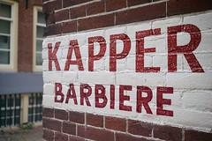 """Kapper Barbiere"" (Eric Flexyourhead) Tags: rokin centrum amsterdam netherlands holland nederland city urban detail fragment sign wall brick kapperbarbiere red white shallowdepthoffield sonyalphaa7 zeisssonnartfe35mmf28za zeiss 35mmf28"