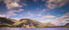 Kilchurn in the sun (jamesdewar99) Tags: kilchurn castle sky clouds blue light argyll hills nikon landscape scotland outdoorphotography