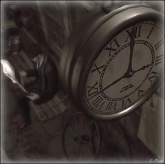 3:00 (Loegan Magic) Tags: secondlife clock trainstation newspaper deadwool suit overcoat bench male sitting