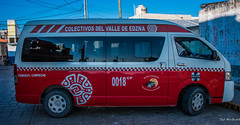 2018 - Mexico - Campeche - Colectivo (Ted's photos - Returns late Feb) Tags: 2018 campeche cropped mexico nikon nikond750 nikonfx tedmcgrath tedsphotos tedsphotosmexico vignetting yucatan colectivo campechecampeche campecheyucatan red redrule bus wheels publictransit