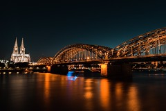 Hohenzollernbrücke (basti k) Tags: langzeitbelichtung night köln cologne dom cathedral bridge rhein sony a6000 sigma nrw hohenzollernbrücke water river arch sky tower building