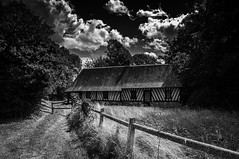 """traditional timber house """"house of the spinners"""", drama in fine art black & white, on  the walk Sentier de l'Ancien Phare, Eure, Normandie, France (grumpybaldprof) Tags: """"sentierdelancienphare"""" walk promenade """"eglisesaintmartin"""" """"fatouvillegrestain"""" """"chateaudelapommeraye"""" """"seineestuary"""" """"ancienphare"""" """"chapelledecarbec"""" """"lavoirdecarbec"""" """"mared'inglemare"""" """"croixd'inglemare"""" panorama """"l'estuaredelaseine"""" """"12thcentury"""" farmland farms animals birds insects plants woods trees """"sainteappolline"""" eure normandy france timber house bw blackwhite """"blackwhite"""" """"blackandwhite"""" noireetblanc monochrome """"fineart"""" ethereal striking artistic interpretation impressionist stylistic style contrast shadow canon 70d """"canon70d"""" tamron 16300 16300mm """"tamron16300mmf3563diiivcpzdb016"""" mood drama spooky"""