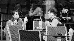 Do I have something in my teeth (byronv2) Tags: edinburgh edimbourg scotland blackandwhite blackwhite bw monochrome street candid peoplewatching cafe coffee cake eating table chair woman girl man boy middlemeadowwalk oldtown asian