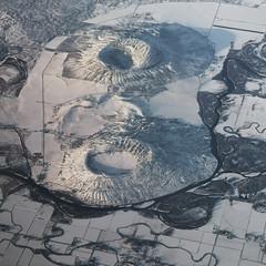 Menan Buttes (StrangeCharmDesign) Tags: landscape aerial flying idaho butte menanbuttes volcano tuff volcaniccone tuffcone snakeriver river winter snow lava lavaflow crater field frozen usa