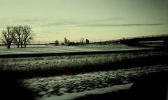 Sur la route vers Québec : La neige à perte de vue... (woltarise) Tags: route transcanadienne autoroute ferme pont neige campagne ricohgr couleurs matin froid tôt
