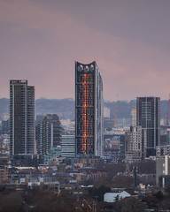 Sun Stripe (JH Images.co.uk) Tags: strata london windturbine hdr dri sunset red clouds city skyline cityscape tower pink