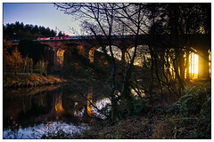 Riverbank sunset. (jester1234) Tags: riverbank sunset train river water trees viaduct