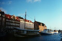 we're traveling on (jesuiselouise) Tags: 35mm film analog lomography400 denmark copenhagen sun sea ship buildings
