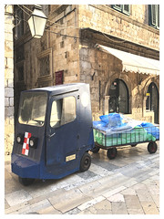 A Dubrovnik Limousine (The Stig 2009) Tags: dubrovnik croatia street cleaning rubbish collecting hotel delivery thestig2009 thestig stig 2009 2019 tony o tonyo apple iphone 8 plus old town trailer trolley three wheel trike electric laundry