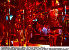"""Sex Bar Bangkok 01 (hoffman) Tags: asia attraction bangkok bankok bar dancers dancing desire drinking female gawping girls gogobar health horizontal indoors lady leisure men morality nakedness night nude nudity performance performing prostitution recreation redlightdistrict sex sexuality stripper stripping thailand tourism tourist unclothed woman women davidhoffman wwwhoffmanphotoscom uk davidhoffmanphotolibrary socialissues reportage stockphotos""""stock photostock photography"""" stockphotographs""""documentarywwwhoffmanphotoscom copyright"""