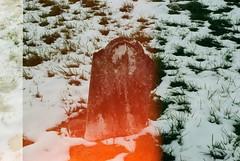 Union Cemetery in Columbia, Missouri (plasticpeaches) Tags: 35mm canon ae1 program vintage retro light leak cemetery graveyard columbia missouri como gravestone headstone snow winter december sad abandoned film filmisnotdead filmisalive filmphotography