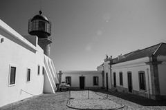 Cabo de São Vicente, Sagres (stephgallant) Tags: portugal algarve faro iberianpenninsula europe southerneurope blackandwhite monochrome highcontrast architecture design church canon60d canon sigma1020mm sigma sigma1020 wideangle cape coastal capestvincent cabosaovicente cliff coast lighthouse sagres vicente bw