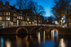 Amsterdam's canals (angheloflores) Tags: amsterdam canal houses architecture night bridge lights colors travel urban explore netherlands longexposure