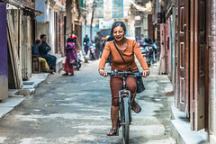 Woman on bicycle, Patan, Nepal (CamelKW) Tags: tibet2018 woman bicycle patan nepal