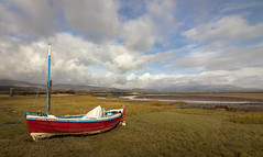 Red Boat (RichySum77) Tags: boat water estuary sea shore hills mountain canon eos 80d seascape landscape nature sky clouds sand bay grass tide low