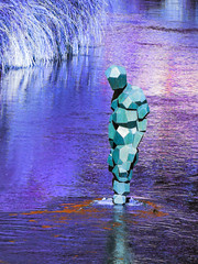 The Planet of the Waning Sun (Steve Taylor (Photography)) Tags: robot sculpture blue mauve purple orange calm metal water river avon newzealand nz southisland canterbury christchurch city grass ripple reflection