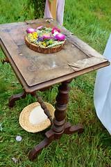 After an outdoor wedding (Yirka51) Tags: figurine wood wooden rice wedding table meadow grass garden flower flour decorated basket