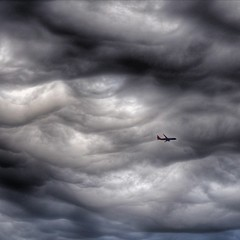 Small by Comparison (2n2907) Tags: dfw dark clouds cloud weather storm plane airplane jet stormy sky front