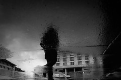 A walking shadow on earth (Black&Light Streetphotographie) Tags: mono monochrome menschen menschenbilder leute lichtundschatten lightandshadows people personen portrait peoples portraits urban tiefenschärfe wow dof deepoffield depthoffield fullframe vollformat sony streets streetshots streetshooting streetportrait street schwarzweis streetphotographie city closeup pfütze puddle rain rainy regen raindrops regentropfen regnerisch availablelight blackandwhite bw blackwhite bokeh bokehlicious blur blurring sw sonya7rii
