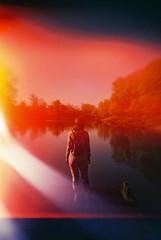 Too much light leaks (elmahiko) Tags: lomo lomography analog light leak film 35mm color girl water river danube novisad serbia surreal fantasy space weird lca fujic200 trippy