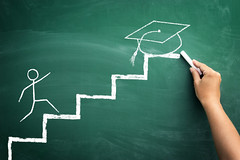 student on steps, illustrated presentation to arrive at the graduation (nithiyabhaskar) Tags: student career success graduation education studying stair school step up climbing study blackboard aspiration chalkboard illustration learning end handwriting stairway knowledge chalk inspiration academic finish college copyspace staircase hand goal achievement idea determination drawing grade future heavy grow background university concept serbia