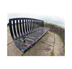 bench (chrisinplymouth) Tags: fisheye seat bench mountpleasantredoubt stoke plymouth devon england uk city cw69x metal diagx plymgrp blockhouse diagonal camminante