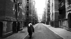 dark city (frax[be]) Tags: streetphotography street atmosphere architecture 16mm fuji city urban outdoor noiretblanc monochrome noir moody blackandwhite bnw