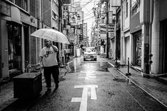 Osaka - Shinsaibashi (-dow-) Tags: giappone japan osaka 大阪 日本 shinsaibashi umbrella ombrello rain pioggia monochrome fujifilm x70